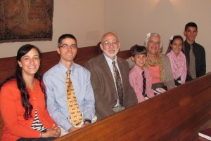 family in pew